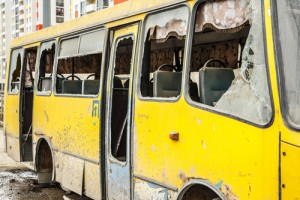 Old dirty yellow bus with broken windows